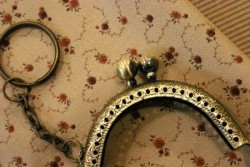 Fermoir de porte monnaie en métal bronze